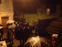 Dangerous when wet! The Hangman warns the Stirling Ramblers to take care as they enter the Auld Kirkyard in heavy rain (don't you just love the Scottish weather?), 21 November 2014 (photo by Denis Taylor)